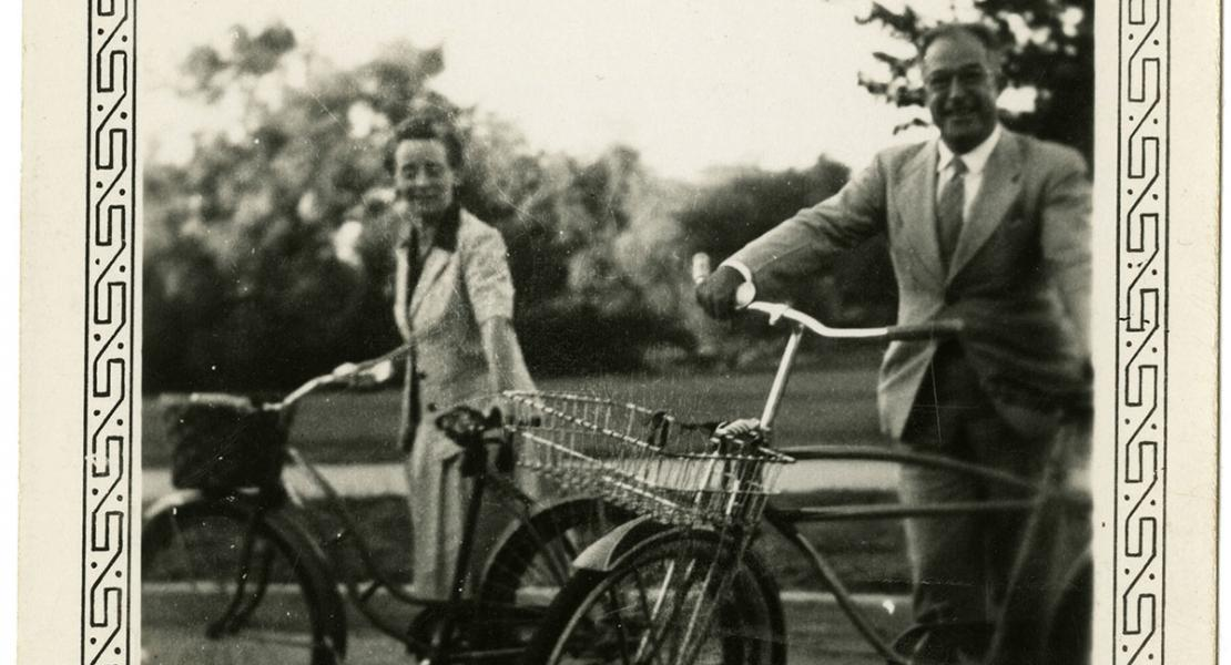 Dorothy Van Dyke Leake and her husband, Harold, riding bicycles on July 4, 1943, in Stillwater, Oklahoma.