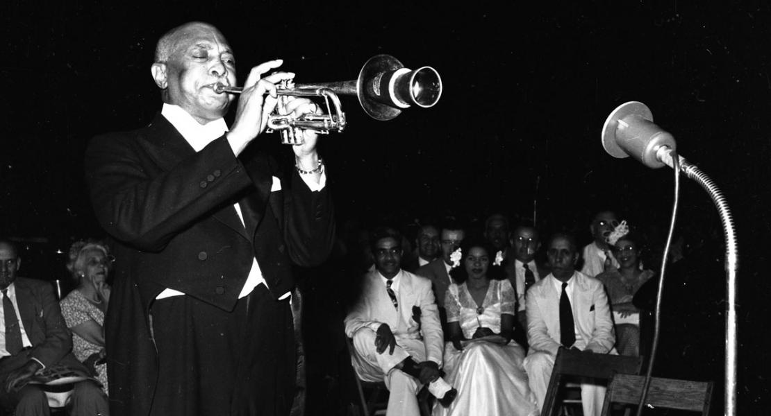 W. C. Handy playing at the fifth annual American Negro Music Festival in St. Louis's Sportsman's Park in 1944. [State Historical Society of Missouri, Arthur Witman 120mm Photograph Collection (S0732), 732.31462]