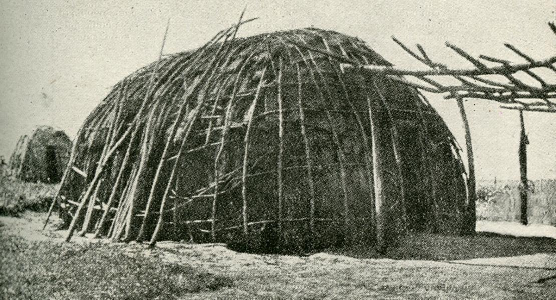 "An Ioway pole house. [David I. Bushnell Jr., ""Villages of the Algonquian, Siouan, and Caddoan Tribes West of the Mississippi,"" Bulletin of the Bureau of American Ethnology no. 77 (1922), Plate 32b between pp. 102 and 103]"